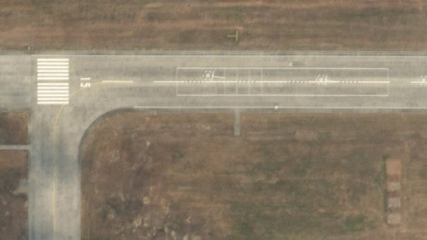 Satellite photos show carrier-deck markings painted on a runway at an unnamed base in Lingshui on Hainan Island. (Planet Labs)