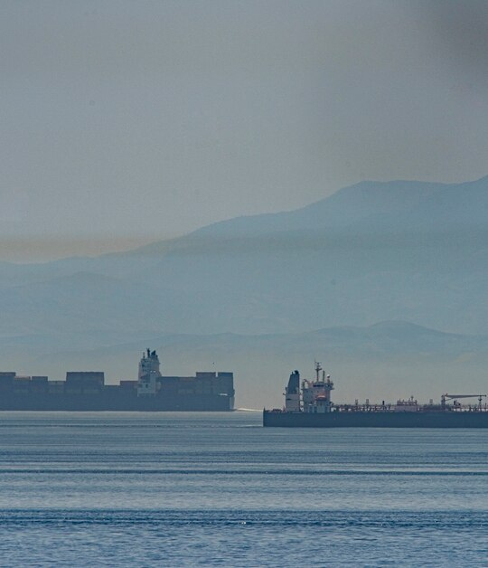 A view of the vessel the Clavel, right, sailing on international waters crossing the Gibraltar stretch on Wednesday, May 20, 2020. (Marcos Moreno/AP)