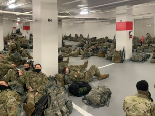 National Guard troops resting after they were ordered to move out of the Senate to a parking garage. (Facebook)