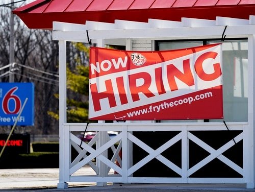 A hiring sign hangs outside of a restaurant in Prospect Heights, Ill., on March 21. (Nam Y. Huh/AP)