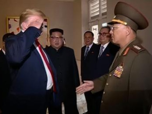 President Trump salutes North Korean Gen. No Kwang Chol during his summit with Kim Jong Un in Singapore. Trump had initially extended his hand to No, but reciprocated in kind when No saluted instead.