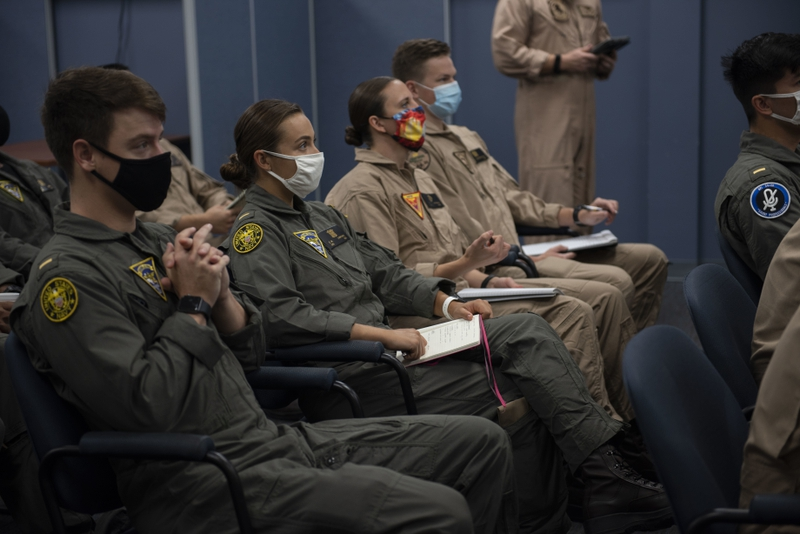 The first students enrolled in Naval Aviation Training Next-Project Avenger receive briefings from dedicated instructors. (Anne Owens/Navy)