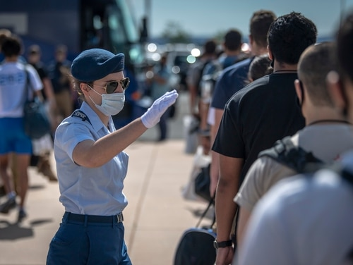 A cadet-cadre member organizes a line of men and women who reported to the U.S. Air Force Academy to begin Basic Cadet Training, June 25. More than 1,100 young men and women were admitted into the Academy's Class of 2024. (Tech. Sgt. Benjamin W. Stratton/Air Force)