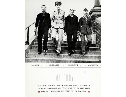 In this October 1943 photo provided by Catholic Central High School, four classmates in military uniform walk down the stairs at Catholic Central High School in Troy, N.Y. From left are John Marcil, John McGrath, Howard McAlonie and Alfred Mahoney. The 75-year-old yearbook photo of the four young men serving during World War II is spurring an effort to locate the lost airplane flown by John McGrath, the only one in the picture not to make it home. (Catholic Central High School via AP)