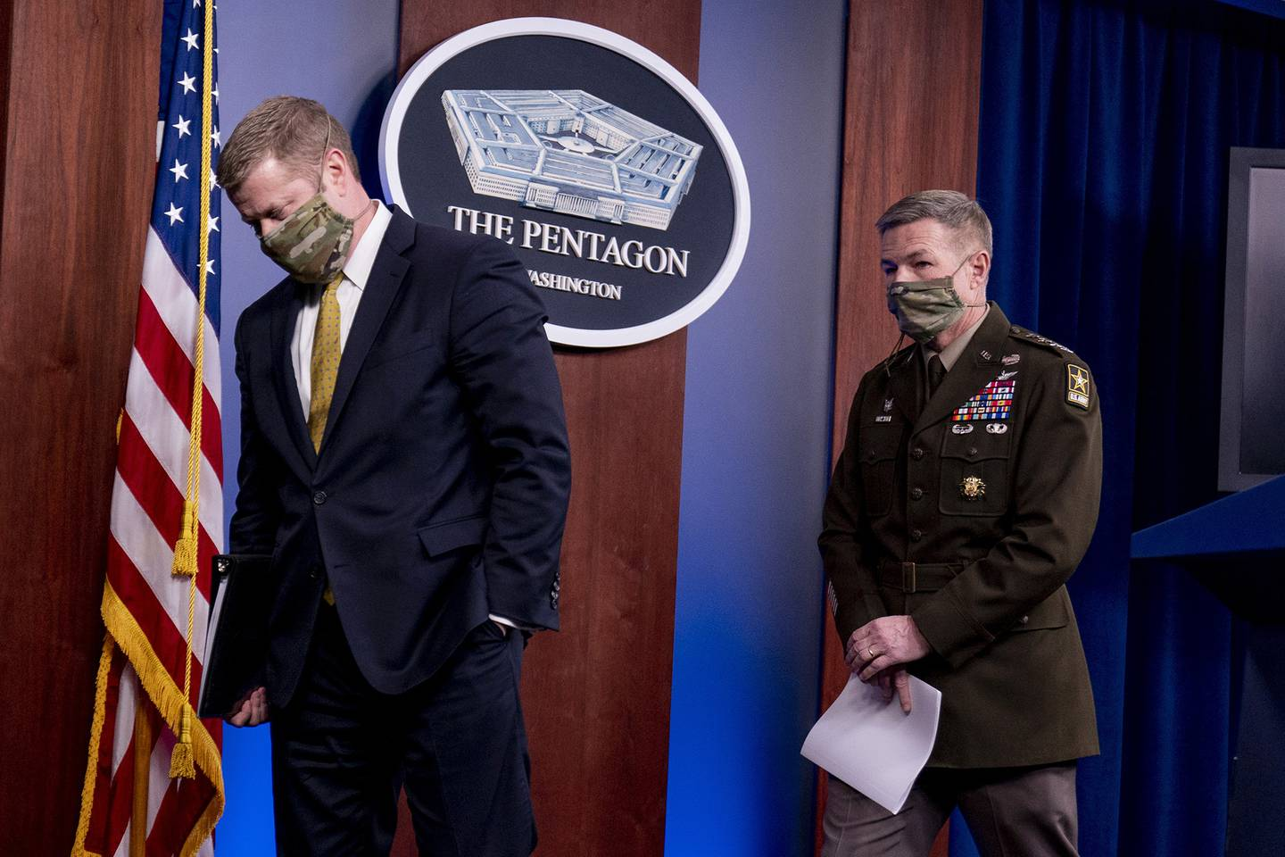 Secretary of the Army Ryan McCarthy, left, and Gen. James McConville, chief of staff of the Army, right, depart after speaking at a briefing on an investigation into Fort Hood, Texas, at the Pentagon, Tuesday, Dec. 8, 2020, in Washington.