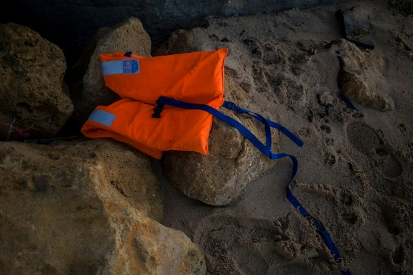 A life vest lies on the rocks near the village of Canos de Meca in southern Spain onTuesday. Spain's maritime rescue service says at least 17 people have died trying to reach Spanish territory in boats departing from North Africa but rescued 80 people Monday from two boats and recovered the bodies of 13 dead migrants in the Alboran Sea, part of the western Mediterranean route into Europe. In a separate incident, the Spanish Civil Guard says it found four bodies of migrants and 22 survivors, all men from northern Africa, after their wooden dinghy hit a reef. (Javier Fergo/AP)