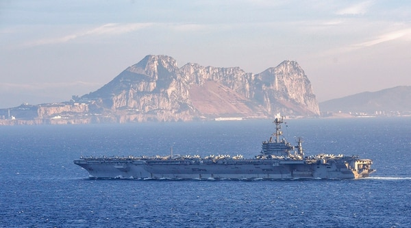 The aircraft carrier Harry S. Truman transits the Straits of Gibraltar, leaving the Mediterranean on June 28, to enter the Atlantic Ocean. The Truman and three escorts are now heading home from Norfolk after only three months deployed. (MC2 Thomas Gooley/Navy)