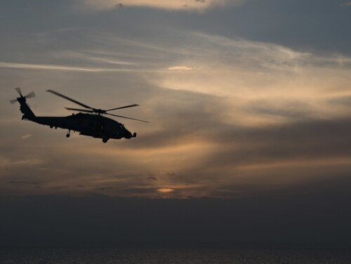 An MH-60R Sea Hawk helicopter, assigned to Helicopter Maritime Strike Squadron 71, flies over the Strait of Hormuz after launching from the guided-missile destroyer Stockdale on April 3. (Mass Communication Specialist 2nd Class Abigayle Lutz/Navy)