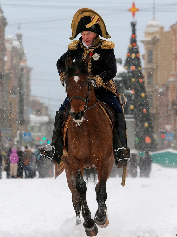 In this Monday, Jan. 7, 2013 photo, Oleg Sokolov, a history professor at St. Petersburg State University, wears a 1812-era French army general's uniform during a reenactment of the French Invasion of Russia in 1812, during celebrations to mark the Russian Orthodox Christmas in St.Petersburg, Russia. (Dmitri Lovetsky/AP)
