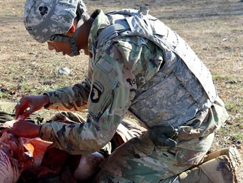 Researchers are working on a hands-free system to help combat medics document treatment in the field. (Army)