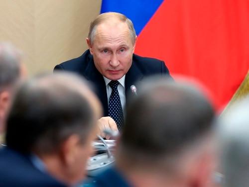Russian President Vladimir Putin chairs a Security Council meeting at the Novo-Ogaryovo residence outside Moscow on Nov. 22, 2019. (Yekaterina Shtukina, Sputnik, Government Pool Photo via AP)