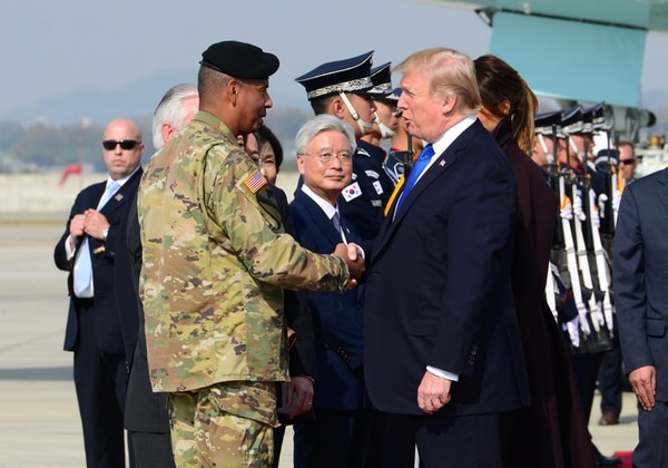 President Donald Trump greets U.S. Army Gen. Vincent Brooks, United States Forces of Korea commander, after landing at Osan Air Base, Republic of Korea, Nov. 7, 2017, as part of his 13-day trip through the Pacific Theater. (Staff Sgt. Alex Echols III/Air Force)