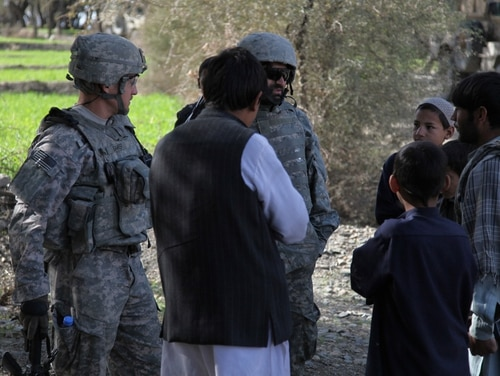 A group of local Afghan villagers speak to an interpreter accompanying U.S. Army soldiers on a patrol in Kowlak valley, Nangahar province, in Afghanistan on Feb. 19, 2010. (Spc. Victor Egorov/Army)