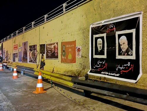 Posters of Iranian Gen. Qassem Soleimani and deputy commander of Iran-backed militias Abu Mahdi al-Muhandis, both killed in a U.S. strike earlier this month, hang on the walls Jan. 16, 2020, at the site where they were killed in Baghdad, Iraq. (Hadi Mizban/AP)