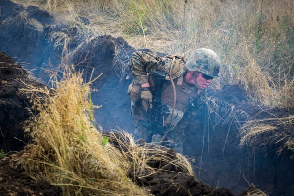 A U.S. Marine runs to a new defensive position and seeks cover from a simulated mortar round during training July 15, 2017, in Shirokyi Lan, Ukraine. (Staff Sgt. Marcin Platek/Marine Corps )