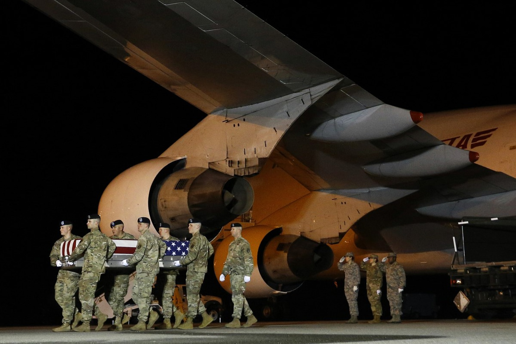 An Army carry team brings the remains of Sgt. Leandro Jasso back to the United States on Nov. 26, 2018. (Patrick Semansky/AP)