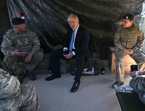 British Prime Minister Boris Johnson meets with military personnel in a hut on Salisbury plain training area on Sept. 19, 2019, in Salisbury, England. (Photo by Ben Stansall - WPA Pool/Getty Images)