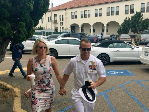 "Special Warfare Operator Chief Edward ""Eddie"" Gallagher, 40, walks with his wife, Andrea, as they arrive to military court at Naval Base San Diego on Thursday. (Julie Watson/AP)"