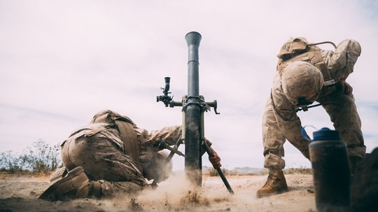 Marines with 3rd Battalion, 2nd Marine Regiment, 2nd Marine Division, fire an 81mm mortar system at Range 630 during Integrated Training Exercise 3-18 aboard the Marine Corps Air Ground Combat Center, Twentynine Palms, California, April 30, 2018.(Lance Cpl. William Chockey/ Marine Corps)