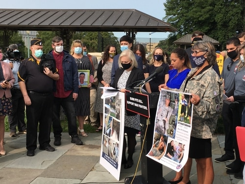Danielle Robinson (center) — whose husband, former Sgt. 1st Class Heath Robinson, died in April — speaks during a Capitol Hill presser advocating for better benefits for the families of burn pit victims on Sept. 15, 2020. (Leo Shane III/Staff)