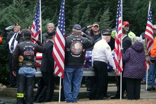 In this Jan. 17, 2019, photo, a flag draped coffin is moved during a funeral for three Memphis veterans, Wesley Russell, 76, Arnold Klechka, 71, Charles Fox, 60, who died this past fall and whose remains were unclaimed in Memphis, Tenn. (Karen Pulfer Focht/AP)