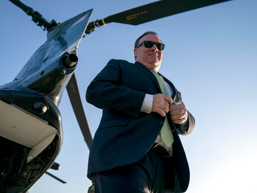 In this July 9, 2018, photo, Secretary of State Mike Pompeo arrives at Camp Alvarado in Kabul, Afghanistan, after meeting with Afghan President Ashraf Ghani. Pompeo used the unannounced trip to step up the Trump administration's calls for peace talks. (Andrew Harnik/Pool via AP)