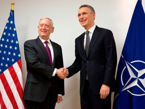 NATO Secretary General Jens Stoltenberg (R) shakes hands with US Secretary for Defense James Mattis during a visit to NATO. The U.S. is expected to be home to a new NATO command focused on maritime security. (VIRGINIA MAYO/AFP/Getty Images)