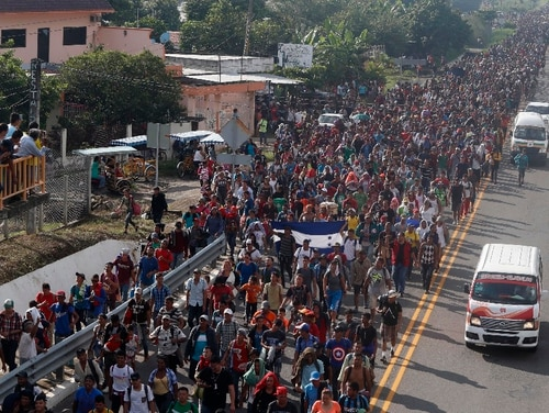 Central American migrants walking toward the U.S. depart Ciudad Hidalgo, Mexico, on Sunday, Oct. 21, 2018, despite Mexican efforts to stop them. The caravan advancing toward the U.S. border is estimated to be at least 7,000 people. As of Tuesday, Oct. 23, they still faced a journey of more than 1,000 miles. (Moises Castillo/Associated Press)