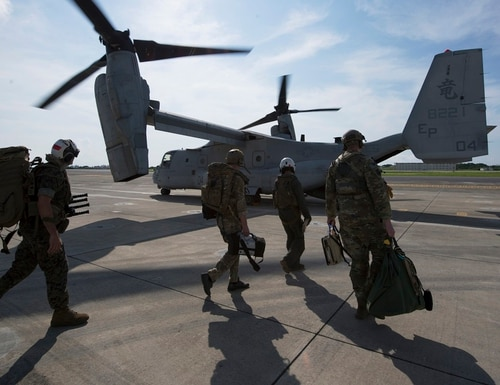 Members of the U.S. Air Force, Navy and Marines, board a MV-22 Osprey June 6, 2018, at Marine Corps Air Station, Japan during an exercise. (Senior Airman Thomas Barle/Air Force)