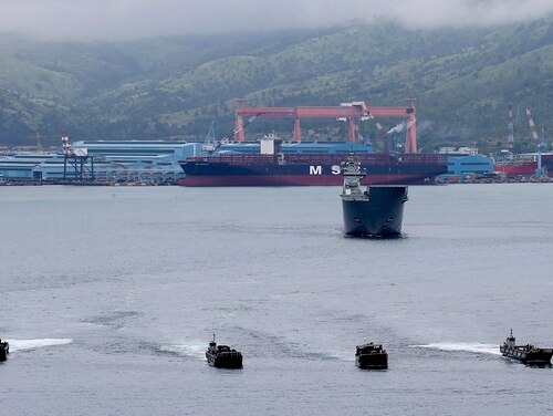 Landing crafts with Philippine Marines and Australian troops on board speed toward a mock disaster site after being dislodged by the Royal Australian Navy HMAS Adelaide during a joint Humanitarian Aid and Disaster Relief exercise off Subic Bay, Philippines, Oct. 15, 2017. (Bullit Marquez/AP)