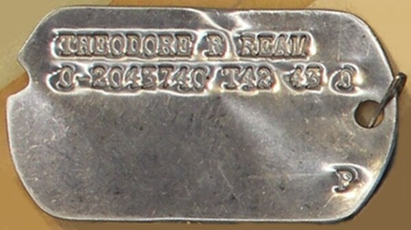 The dog tag of Army Air Forces 1st Lt. Theodore Ream was given to his sister, before it was retrieved by the government. (National Archives)