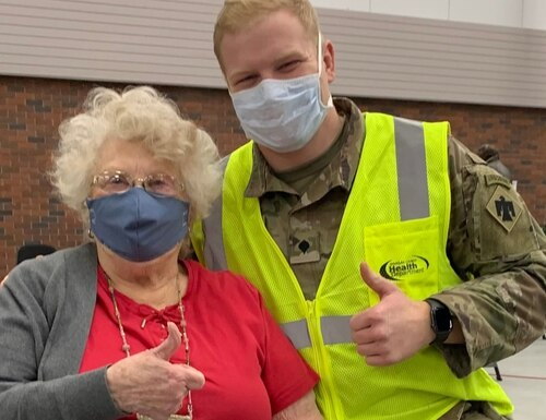 Nebraska Army National Guard Spc. Garett Rollag, a combat medic, recently administered both doses of COVID-19 vaccine to his grandmother, Marilyn Bachmann. (Courtesy photo)