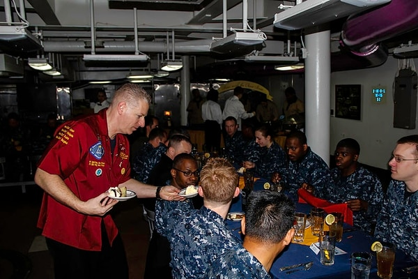 U.S. Navy Chief Warrant Officer 2 Brian Ware, left, a food services officer aboard the aircraft carrier George Washington, serves junior sailors and their departmental leaders in April 2013. Ware was recently charged in the 'Fat Leonard' scandal. (MC2 Benjamin K. Kittleson)