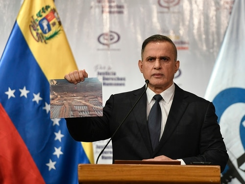Venezuela's Attorney General Tarek William Saab holds a photo of bullets he says were seized with other weapons in connection with what the government calls a failed attack aimed at overthrowing President Nicolás Maduro, during a press conference in Caracas, Venezuela, May 8, 2020. (Matias Delacroix/AP)