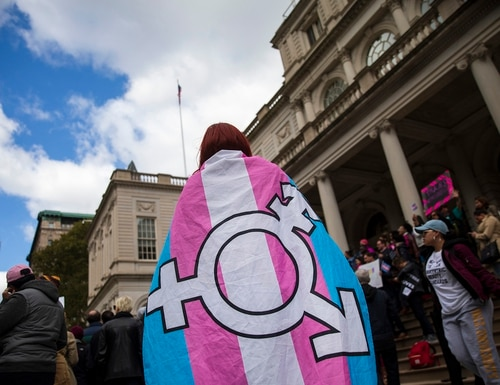LGBT activists rally in support of transgender people on the steps of New York City Hall on Oct. 24, 2018. (Drew Angerer/Getty Images)