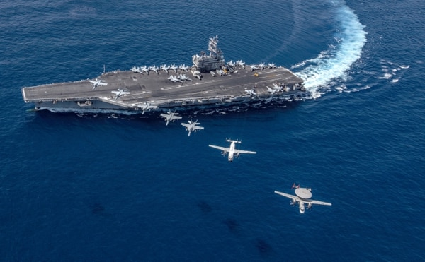 Multiple aircraft from Carrier Air Wing 5 fly in formation over the Navy's forward-deployed aircraft carrier Ronald Reagan. (Mass Communication Specialist 2nd Class Kaila V. Peters/Navy)