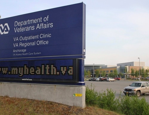 In this photo taken June 18, 2015, a sign flashes outside the Veterans Administration Outpatient Clinic in Anchorage Alaska. (Mark Thiessen/AP)