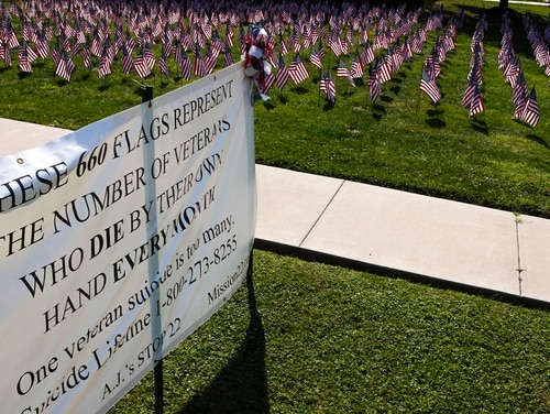 American flags representing the number of veterans who die by suicide each year are on display at St. Peter's Reformed Church in Zelienople, Pa., on Aug. 30, 2019. (Keith Srakocic/AP)