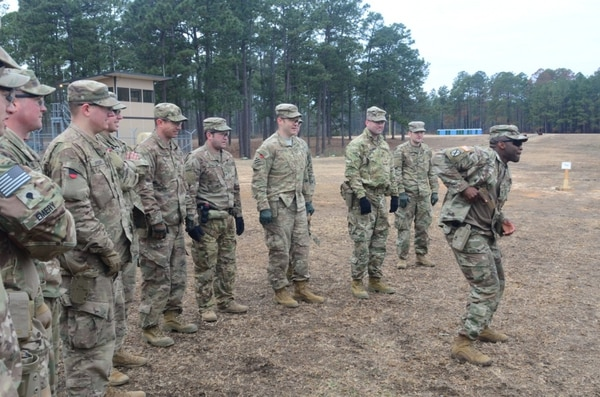 Soldiers from 1st Security Force Assistance Brigade Headquarters, received a demonstration from Staff Sgt. Curtis Graham, an instructor at the XM17 range, Jan. 19, 2018, on how to properly shoot as part of their training at the Joint Readiness Training Center at Fort Polk, La. (Photo credit: U.S. Army photo Sgt. Ryan Tatum)
