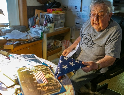 Robert Teichgraeber, 100, talks about the many gifts and honors he has received for his service in World War II on Nov. 6, 2020 in Collinsville, Ill. (Derik Holtmann/Belleville News-Democrat via AP)
