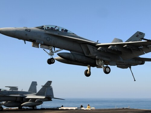 An F/A-18F Super Hornet assigned to the Bounty Hunters of Strike Fighter Squadron (VFA) 2 prepares to land on the flight deck of the Nimitz-class aircraft carrier USS Abraham Lincoln (CVN 72). Lincoln is on a regularly scheduled deployment in support of maritime security operations and theater security cooperation efforts in the U.S. 6th Fleet area of responsibility. (U.S. Navy photo by Mass Communication Specialist Seaman Joshua E. Walters)