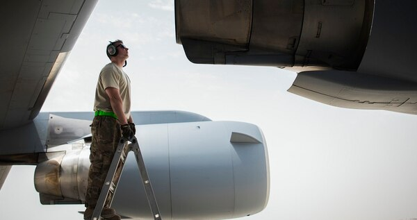 Senior Airman Eric Pashnick, 5th Expeditionary Air Mobility Squadron crew chief, inspects an engine on a C-17 Globemaster III aircraft in May at an undisclosed location in Southwest Asia. (Staff Sgt. Christopher Stoltz/Air Force)