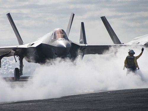 Sailors direct an F-35C Lightning II jet assigned to the Argonauts of Strike Fighter Squadron 147 on the flight deck of the aircraft carrier Carl Vinson. (MC3 Class Ethan J. Soto/Navy)