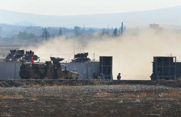 In this photo taken from the outskirts of the village of Mert Ismail near the town of Suruc, southeastern Turkey, Turkish army vehicles return to Tirley from Syrian after conducting a joint patrol with Russian forces, Tuesday, Nov. 5, 2019. (Mehmet Guzel/AP)