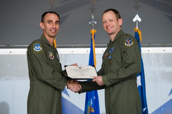 "Maj. Matthew ""Chowder""' Cichowski, 74th Fighter Squadron A-10C Thunderbolt II pilot, receives a Distinguished Flying Cross with valor during an award ceremony on May 23, at Moody Air Force Base, Georgia. (Senior Airman Janiqua P. Robinson/Air Force)"