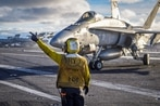 Navy's F/A-18 Legacy Hornet completes its sundown cruise aboard the carrier Vinson