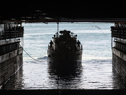 A U.S. Navy Mark VI patrol boat navigates into the well deck of dock landing ship Ashland at Naval Base Guam on Feb. 21, 2021. (Sgt. Danny Gonzalez/U.S. Marine Corps)