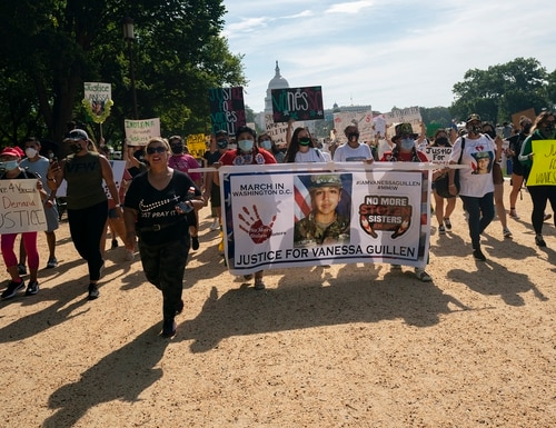 Supporters of the family of slain Army Spc. Vanessa Guillen march along the National Mall to the White House after a news conference July 30 in Washington. (Carolyn Kaster/AP)