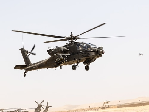 U.S. Army AH-64E Apache pilots land for fuel in Kunduz, Afghanistan. Egypt seeks to purchase 10 of the newest Apache. (Capt. Brian Harris/U.S. Army)