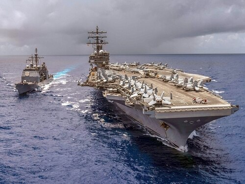 The Ticonderoga-class guided-missile cruiser Antietam pulls alongside the Navy's forward-deployed aircraft carrier, Ronald Reagan, in the Philippine Sea. (Navy)